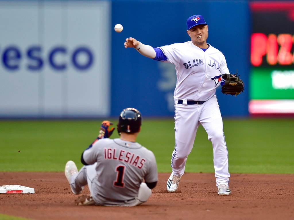 . Detroit Tigers\' Jose Iglesias (1) is out at second on a double play as Toronto Blue Jays shortstop Aledmys Diaz (1) throws to first during the third inning of a baseball game Friday, June 29, 2018, in Toronto. Dixon Machado was out at first. (Frank Gunn/The Canadian Press via AP)