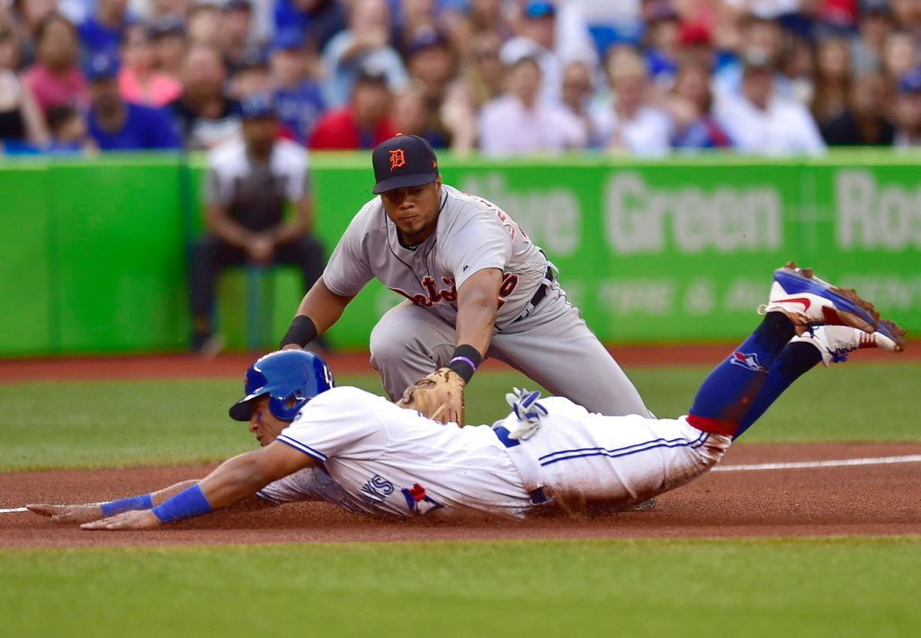 . Toronto Blue Jays\' Yangervis Solarte (26) is out at third as Detroit Tigers third baseman Jeimer Candelario (46) makes the tag during the fourth inning of a baseball game Friday, June 29, 2018, in Toronto. (Frank Gunn/The Canadian Press via AP)