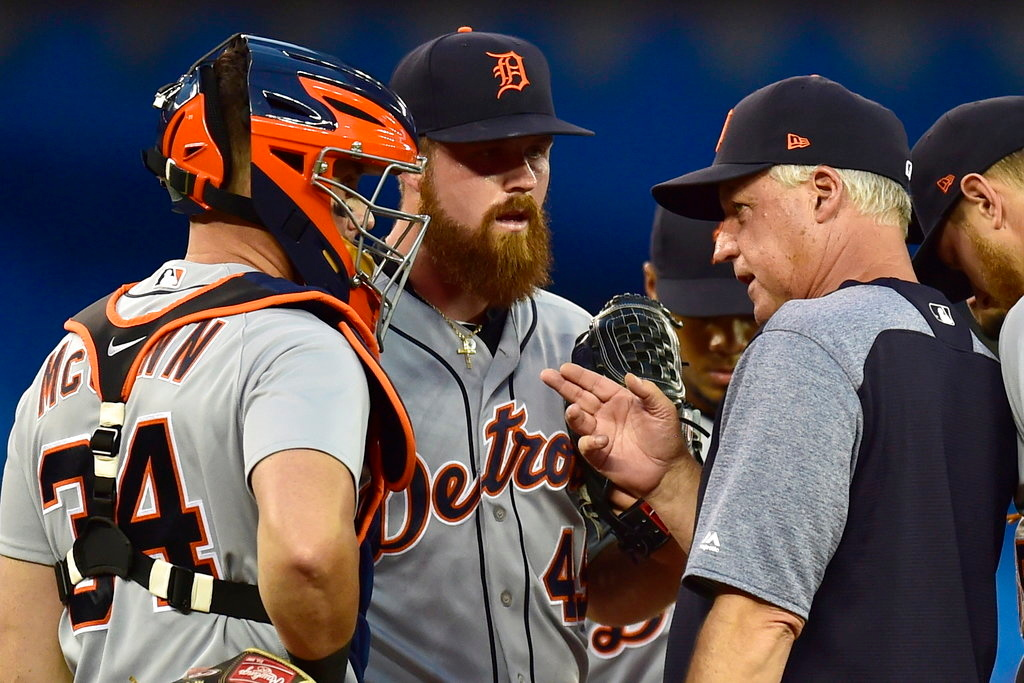. Detroit Tigers pitching coach Rick Anderson, right, speaks with relief pitcher Buck Farmer (45) and catcher James McCann (34) during the seventh inning of the team\'s baseball game against the Toronto Blue Jays on Friday, June 29, 2018, in Toronto. (Frank Gunn/The Canadian Press via AP)