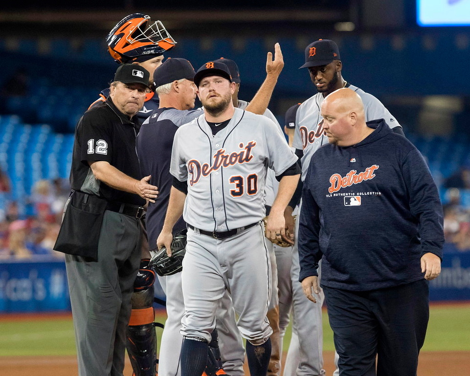 . Detroit Tigers pitcher Alex Wilson is taken out in the eighth inning of a baseball game against the Toronto Blue Jays in Toronto on Saturday, June 30, 2018. (Fred Thornhill/The Canadian Press via AP)