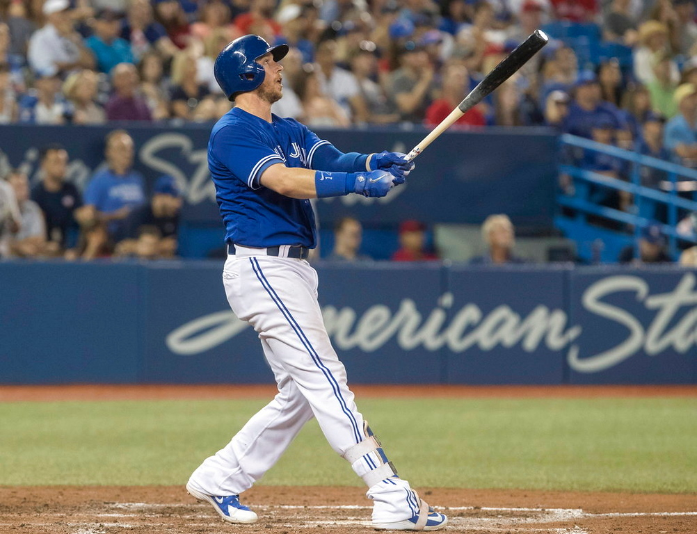 . Toronto Blue Jays\' Justin Smoak watches his game-winning home run defeat the Detroit Tigers 4-3 in the ninth inning of a baseball game in Toronto on Saturday, June 30, 2018. (Fred Thornhill/The Canadian Press via AP)