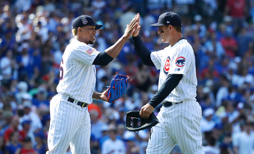 . Chicago Cubs relief pitcher Pedro Strop, left, and first baseman Anthony Rizzo celebrate the team\'s 5-3 win over the Detroit Tigers after a baseball game Tuesday, July 3, 2018, in Chicago. (AP Photo/Charles Rex Arbogast)