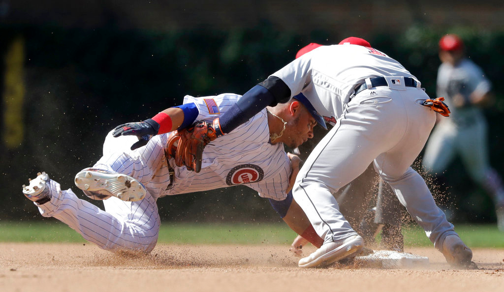 . Detroit Tigers shortstop Jose Iglesias tags out Chicago Cubs\' Willson Contreras at second as Contreras tried to stretch his single to a double during the eighth inning of a baseball game Tuesday, July 3, 2018, in Chicago. (AP Photo/Charles Rex Arbogast)