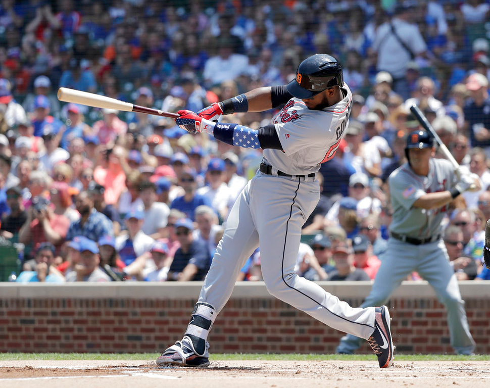 . Detroit Tigers\' Niko Goodrum hits an RBI double off Chicago Cubs starting pitcher Kyle Hendricks during the first inning of a baseball game Tuesday, July 3, 2018, in Chicago. Jeimer Candelario scored. (AP Photo/Charles Rex Arbogast)