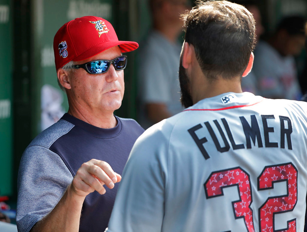 . Detroit Tigers pitching coach Rick Anderson, left, talks with starter Michael Fulmer during the seventh inning of a baseball game against the Chicago Cubs Tuesday, July 3, 2018, in Chicago. (AP Photo/Charles Rex Arbogast)