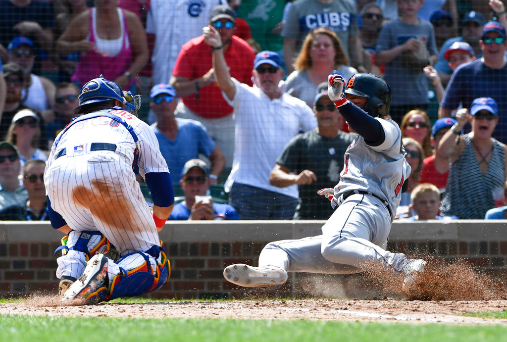 . Detroit Tigers\' Jose Iglesias (1) is tagged out at home plate by Chicago Cubs catcher Willson Contreras (40) during the seventh inning of a baseball game on Wednesday, July 4, 2018, in Chicago. (AP Photo/Matt Marton)