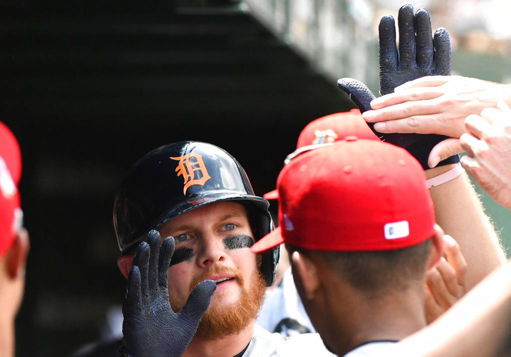 . Detroit Tigers\' John Hicks celebrates in the dugout after his home run during the third inning of a baseball game against the Chicago Cubs on Wednesday, July 4, 2018, in Chicago. (AP Photo/Matt Marton)