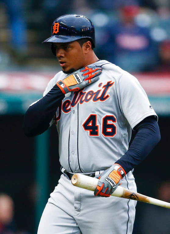 . Detroit Tigers\' Jeimer Candelario reacts after striking out to Cleveland Indians starting pitcher Carlos Carrasco during the fourth inning of a baseball game Wednesday, April 11, 2018, in Cleveland. The Indians won 5-1. (AP Photo/Ron Schwane)