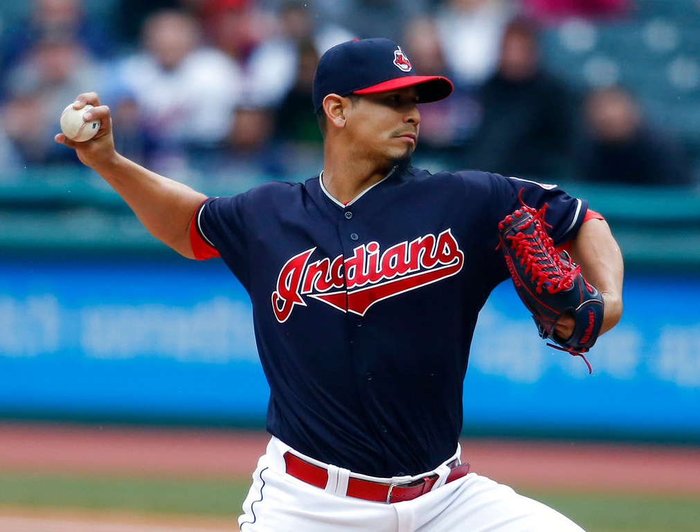 . Cleveland Indians starting pitcher Carlos Carrasco delivers against the Detroit Tigers during the first inning of a baseball game Wednesday, April 11, 2018, in Cleveland. (AP Photo/Ron Schwane)