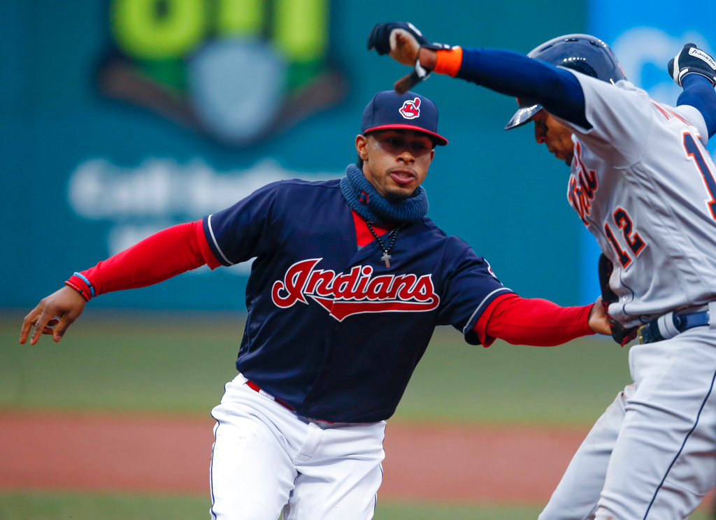 . Cleveland Indians\' Francisco Lindor, left, tags out Detroit Tigers\' Leonys Martin (12) attempting to steal second base during the third inning in a baseball game Wednesday, April 11, 2018, in Cleveland. (AP Photo/Ron Schwane)