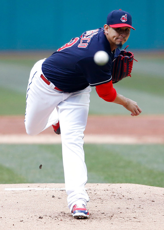 . Cleveland Indians starting pitcher Carlos Carrasco delivers against the Detroit Tigers during the first inning in a baseball game, Wednesday, April 11, 2018, in Cleveland. (AP Photo/Ron Schwane)
