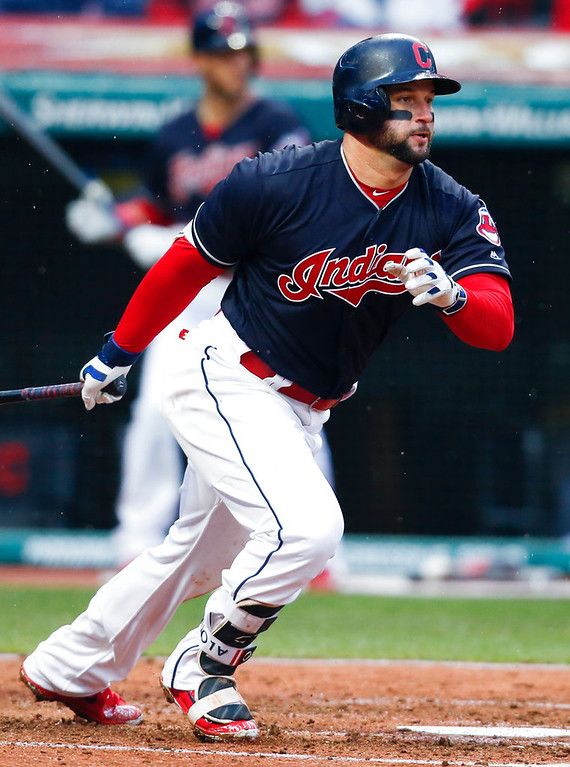 . Cleveland Indians\' Yonder Alonso watches his two-run single off Detroit Tigers pitcher Daniel Norris during the fourth inning of a baseball game Wednesday, April 11, 2018, in Cleveland. (AP Photo/Ron Schwane)