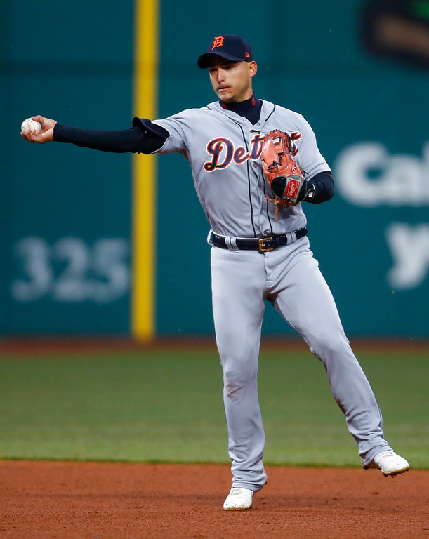 . Detroit Tigers\' Jose Iglesias throws out Cleveland Indians\' Francisco Lindor at first base during the sixth inning in a baseball game, Wednesday, April 11, 2018, in Cleveland. (AP Photo/Ron Schwane)