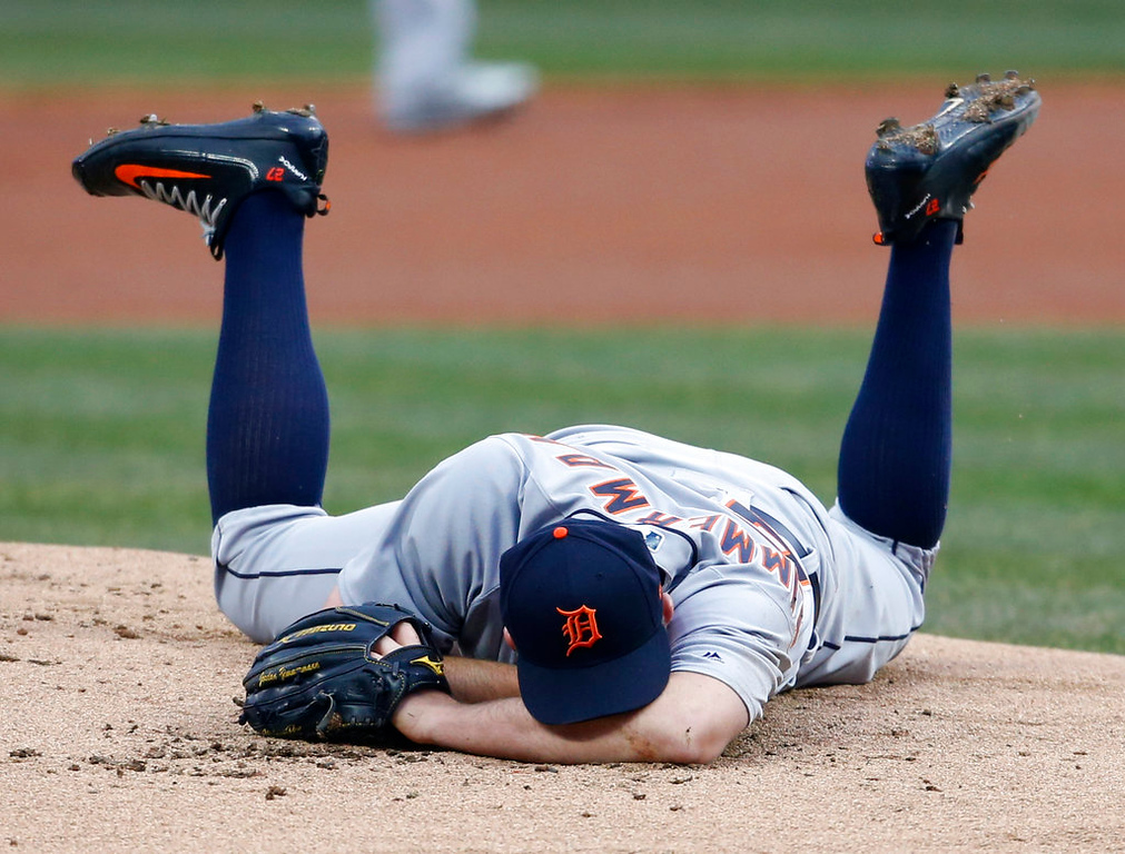 . Detroit Tigers starting pitcher Jordan Zimmermann lays on the mound after getting hit by a ball off the bat of Cleveland Indians\' Jason Kipnis during the first inning in a baseball game, Wednesday, April 11, 2018, in Cleveland. (AP Photo/Ron Schwane)