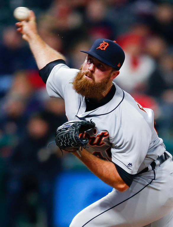 . Detroit Tigers relief pitcher Buck Farmer delivers against the Cleveland Indians during the seventh inning in a baseball game, Wednesday, April 11, 2018, in Cleveland. (AP Photo/Ron Schwane)