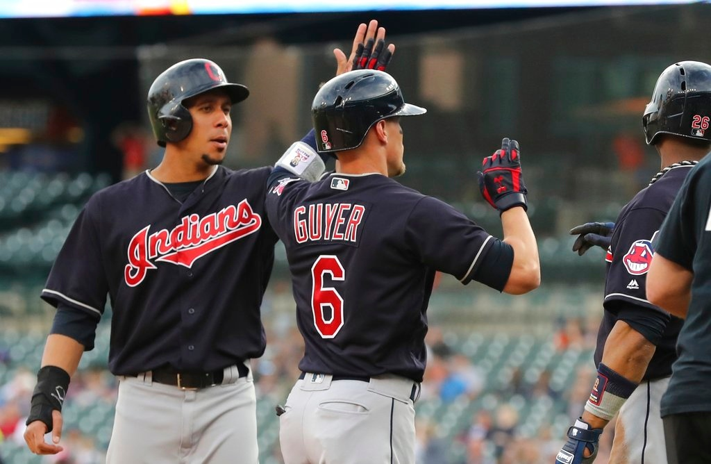 . Cleveland Indians\' Brandon Guyer (6) is congratulated after his grand slam during the first inning of a baseball game against the Detroit Tigers, Tuesday, May 15, 2018, in Detroit. (AP Photo/Carlos Osorio)