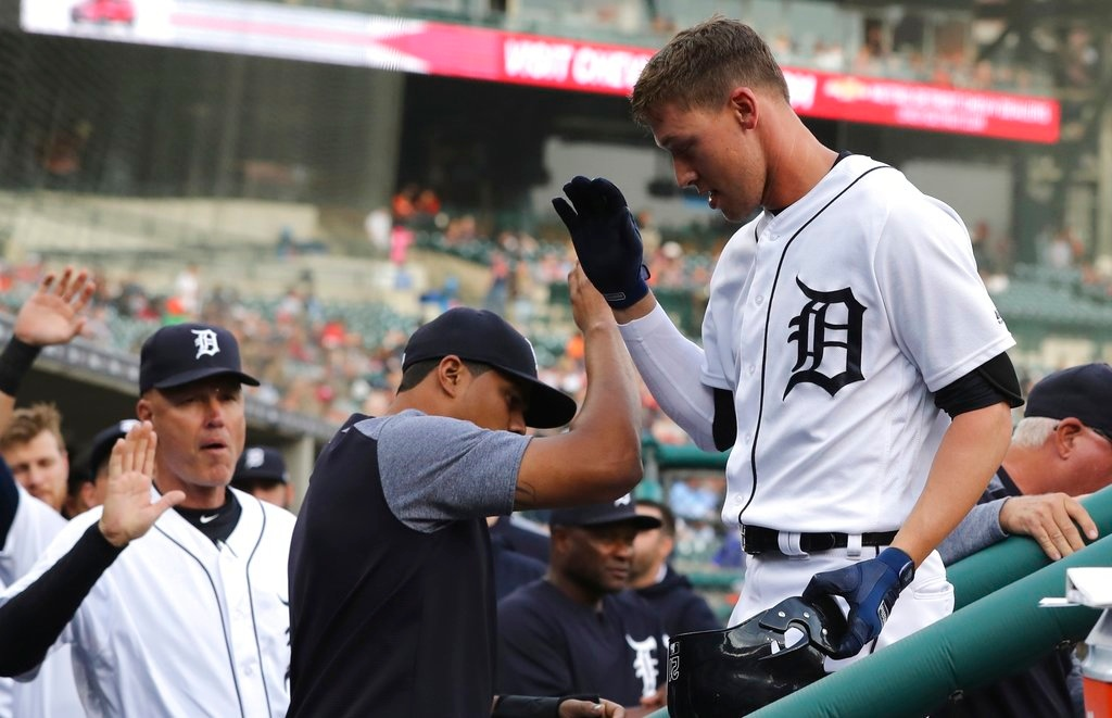 . Detroit Tigers\' JaCoby Jones is greeted in the dugout after his solo home run during the first inning of a baseball game against the Cleveland Indians, Tuesday, May 15, 2018, in Detroit. (AP Photo/Carlos Osorio)