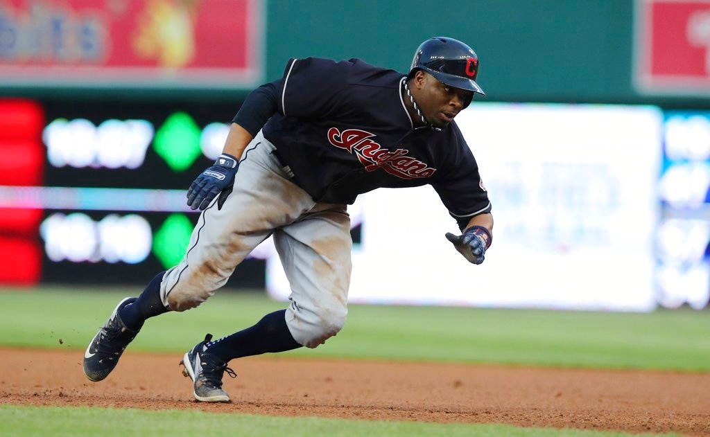 . Cleveland Indians\' Rajai Davis jumps back to first during the fourth inning of a baseball game against the Detroit Tigers, Tuesday, May 15, 2018, in Detroit. (AP Photo/Carlos Osorio)