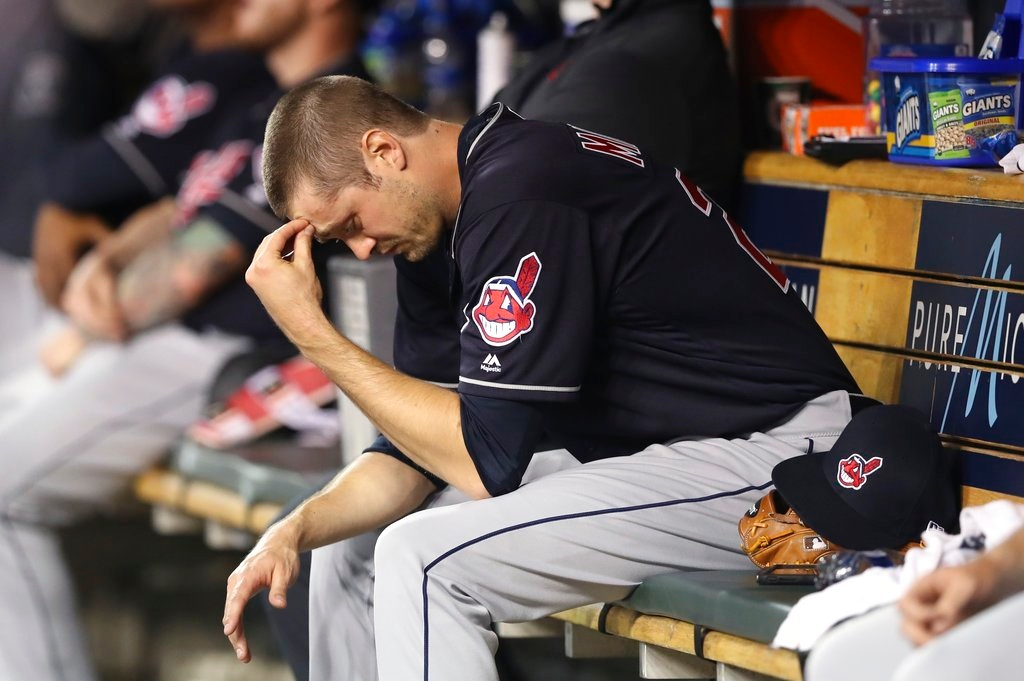 . Cleveland Indians relief pitcher Andrew Miller sits in the dugout after being removed, having given up a bases-loaded walk during the seventh inning of a baseball game against the Detroit Tigers, Tuesday, May 15, 2018, in Detroit. (AP Photo/Carlos Osorio)