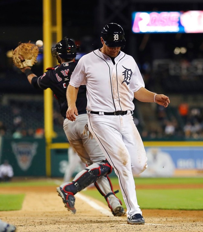. Detroit Tigers\' John Hicks beats the throw to Cleveland Indians catcher Yan Gomes to score during the seventh inning of a baseball game, Tuesday, May 15, 2018, in Detroit. (AP Photo/Carlos Osorio)