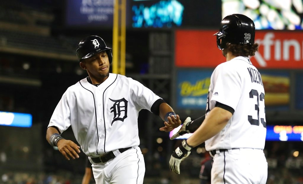 . Detroit Tigers\' Dixon Machado is congratulated by Pete Kozma after scoring during the seventh inning of a baseball game against the Cleveland Indians, Tuesday, May 15, 2018, in Detroit. (AP Photo/Carlos Osorio)