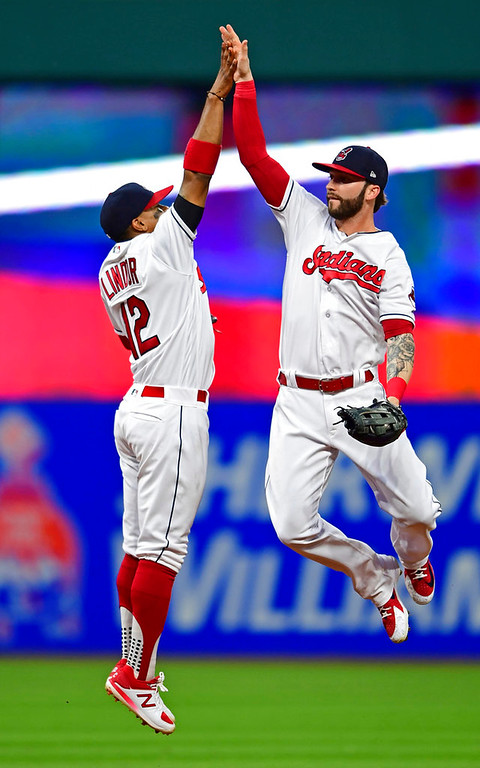 . Cleveland Indians\' Francisco Lindor, left, and Tyler Naquin celebrate after defeating the Detroit Tigers in a baseball game, Saturday, June 23, 2018, in Cleveland. (AP Photo/David Dermer)