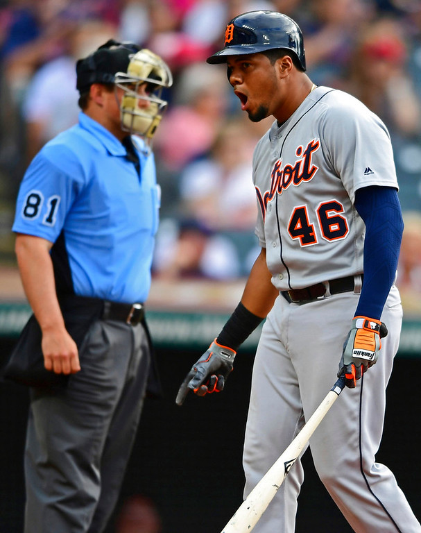 . Detroit Tigers\' Jeimer Candelario, right, reacts after striking out to Cleveland Indians starting pitcher Trevor Bauer during the fifth inning of a baseball game Saturday, June 23, 2018, in Cleveland. (AP Photo/David Dermer)
