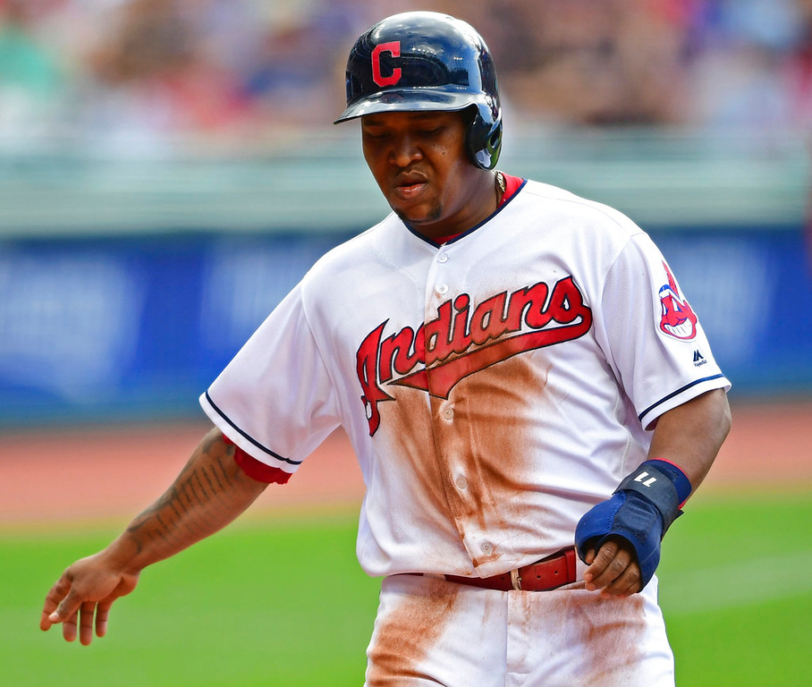 . Cleveland Indians\' Jose Ramirez scores on an RBI-single by Edwin Encarnacion in the first inning of a baseball game against the Detroit Tigers, Saturday, June 23, 2018, in Cleveland. (AP Photo/David Dermer)