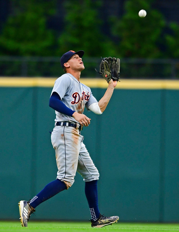 . Detroit Tigers\' JaCoby Jones catches a fly ball hit by Cleveland Indians\' Michael Brantley during the seventh inning of a baseball game Saturday, June 23, 2018, in Cleveland. (AP Photo/David Dermer)