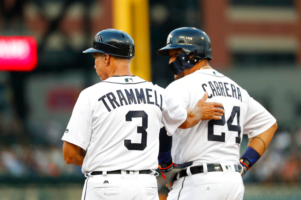 . Detroit Tigers\' first base coach Alan Trammell (3) pats Miguel Cabrera on the back after his single in the third inning of a baseball game against the Cleveland Indians in Detroit, Friday, June 8, 2018. (AP Photo/Paul Sancya)