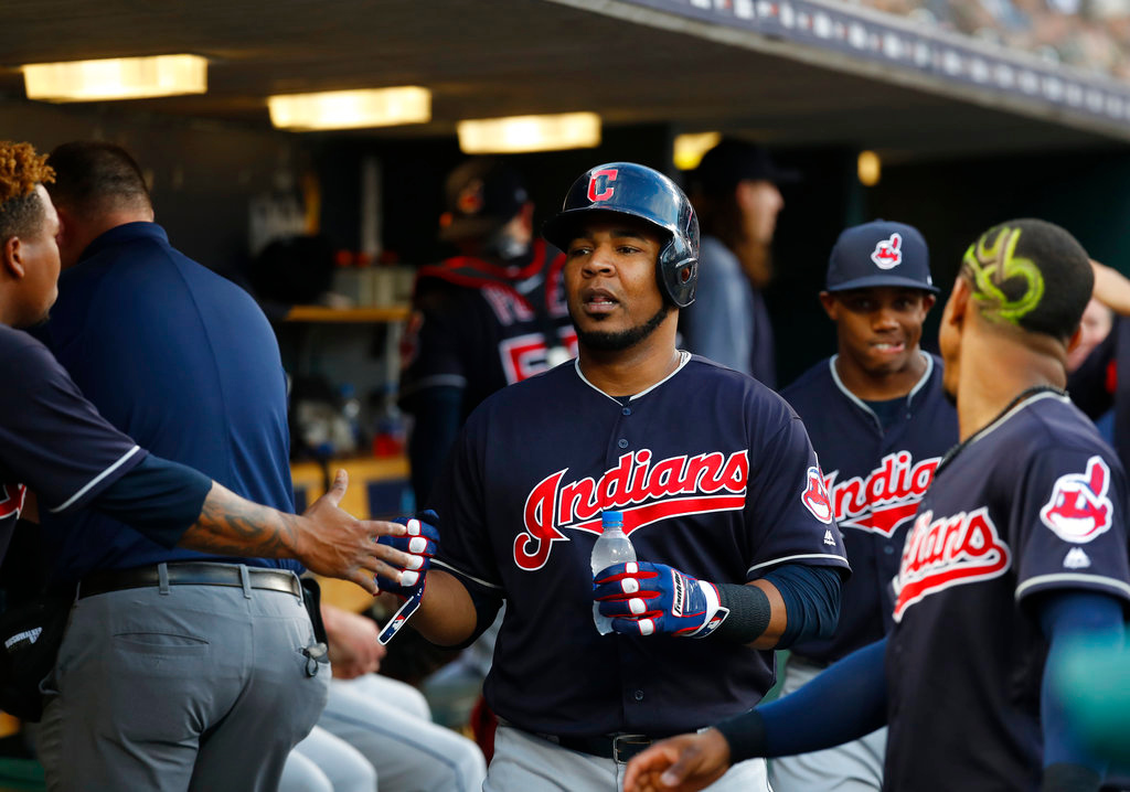 . Cleveland Indians\' Edwin Encarnacion celebrates scoring on a Yonder Alonso double in the fourth inning of a baseball game against the Detroit Tigers in Detroit, Friday, June 8, 2018. (AP Photo/Paul Sancya)