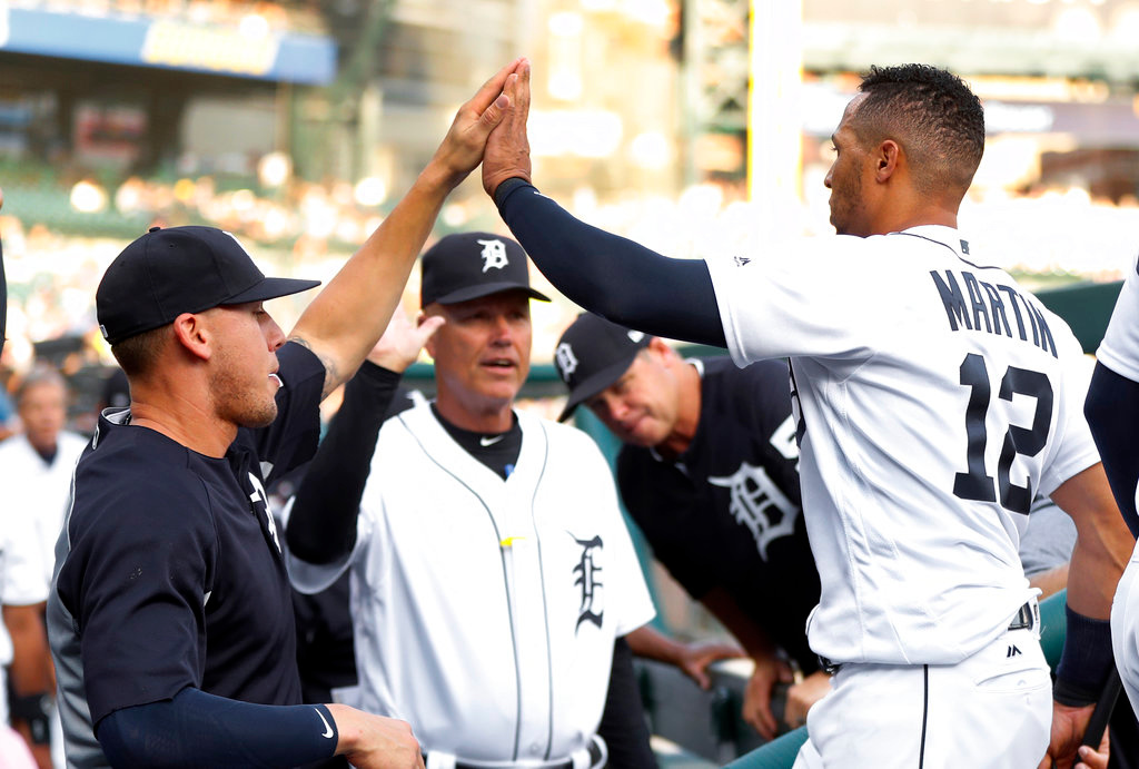 . Detroit Tigers\' Leonys Martin (12) celebrates after scoring on a Nicholas Castellanos double in the first inning of a baseball game against the Cleveland Indians in Detroit, Friday, June 8, 2018. (AP Photo/Paul Sancya)