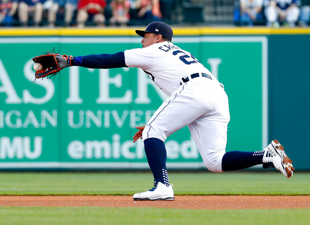. Detroit Tigers first baseman Miguel Cabrera can\'t make the catch on a Cleveland Indians\' Michael Brantley ground ball in the first inning of a baseball game in Detroit, Friday, June 8, 2018. (AP Photo/Paul Sancya)