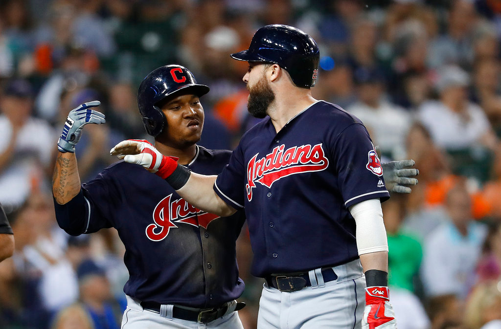 . Cleveland Indians\' Jason Kipnis, right, celebrates hitting a three-run home run off Detroit Tigers relief pitcher Shane Greene with Jose Ramirez in the ninth inning of a baseball game in Detroit, Friday, June 8, 2018. (AP Photo/Paul Sancya)