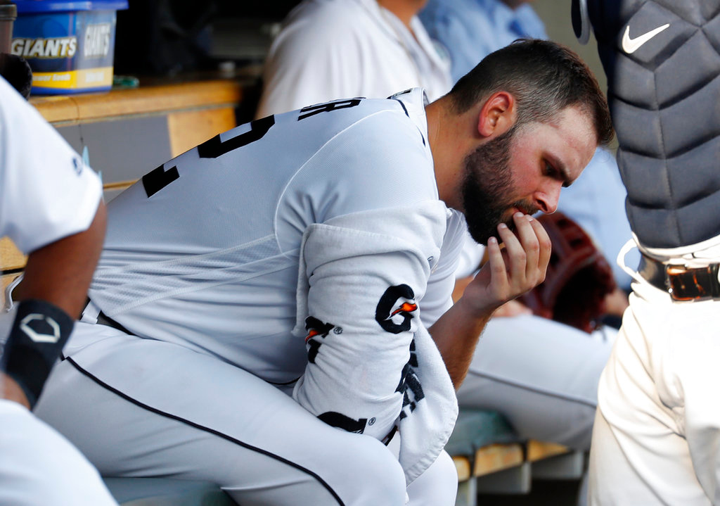 . Detroit Tigers pitcher Michael Fulmer sits in the dugout before a baseball game against the Cleveland Indians in Detroit, Friday, June 8, 2018. (AP Photo/Paul Sancya)