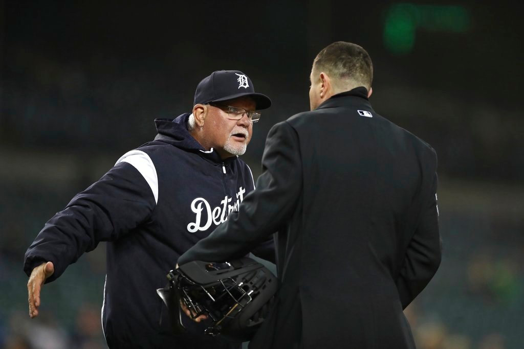 . Detroit Tigers manager Ron Gardenhire, left, argues with home plate umpire Carlos Torres after being ejected during the fifth inning of the second game of a baseball doubleheader against the Seattle Mariners, Saturday, May 12, 2018, in Detroit. (AP Photo/Carlos Osorio)