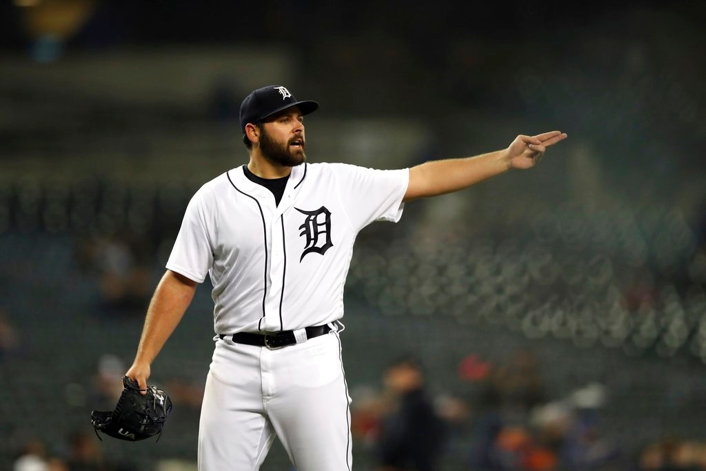 . Detroit Tigers starting pitcher Michael Fulmer disputes calls with home plate umpire Carlos Torres after being relieved during the fifth inning of the second game of a baseball doubleheader against the Seattle Mariners, Saturday, May 12, 2018, in Detroit. (AP Photo/Carlos Osorio)