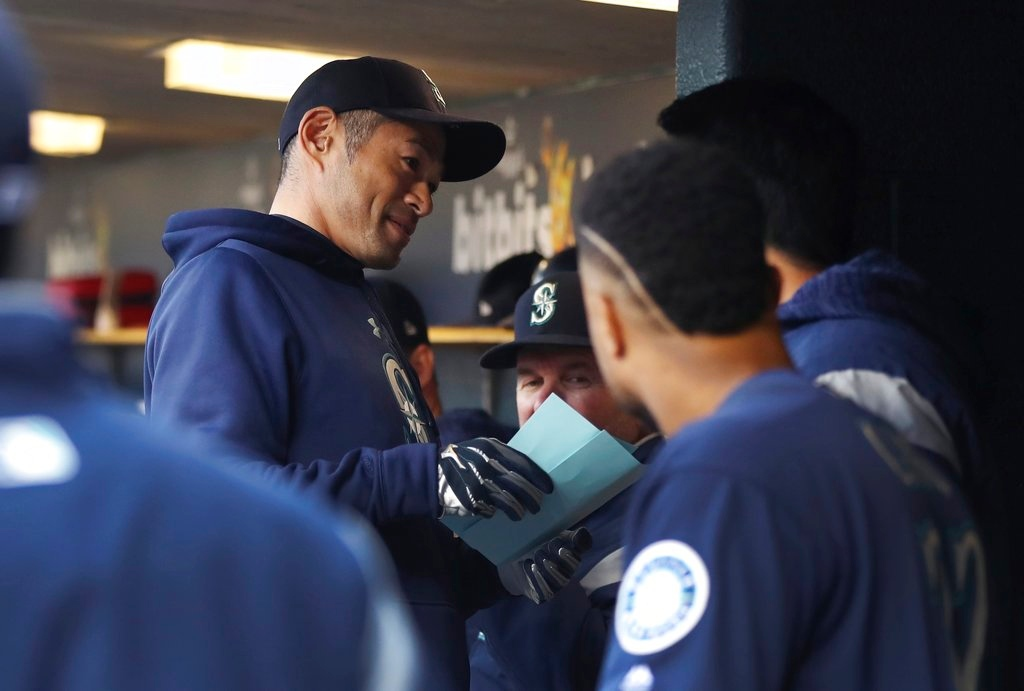 . Seattle Mariners acting bench coach Ichiro Suzuki looks over the lineup before game two of a baseball doubleheader against the Detroit Tigers, Saturday, May 12, 2018, in Detroit. (AP Photo/Carlos Osorio)