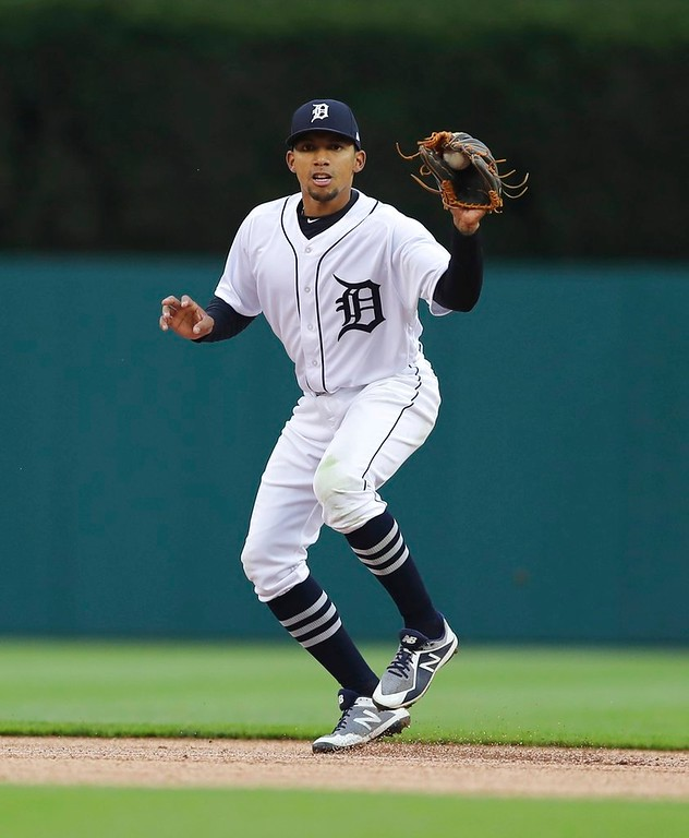 . Detroit Tigers shortstop Dixon Machado fields a grounder during the first inning of game two of a baseball doubleheader against the Seattle Mariners, Saturday, May 12, 2018, in Detroit. (AP Photo/Carlos Osorio)