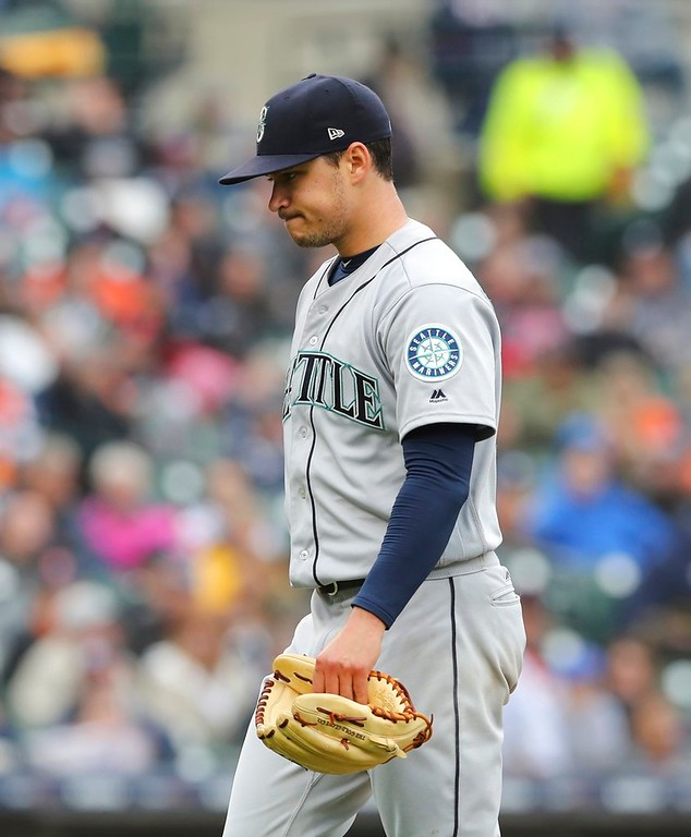 . Seattle Mariners starting pitcher Marco Gonzales walks off the mound after the sixth inning of the first game of a baseball doubleheader against the Detroit Tigers, Saturday, May 12, 2018, in Detroit. (AP Photo/Carlos Osorio)