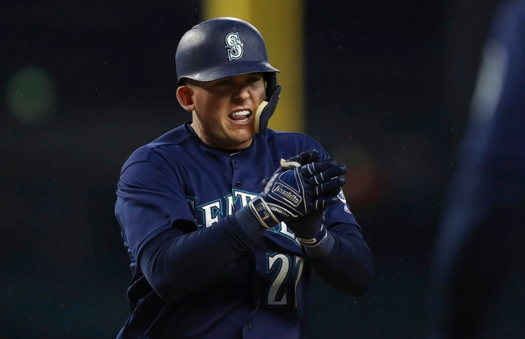 . Seattle Mariners\' Ryon Healy reacts as he approaches home plate after his two-run home run during the fourth inning of the second game of a baseball doubleheader against the Detroit Tigers, Saturday, May 12, 2018, in Detroit. (AP Photo/Carlos Osorio)