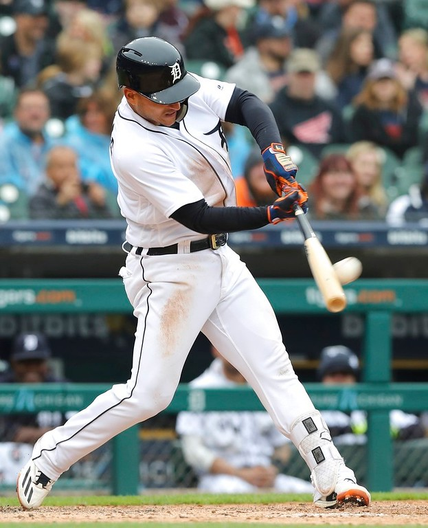 . Detroit Tigers\' Jose Iglesias connects for a two-run home run during the sixth inning of the first game of a baseball doubleheader against the Seattle Mariners, Saturday, May 12, 2018, in Detroit. (AP Photo/Carlos Osorio)