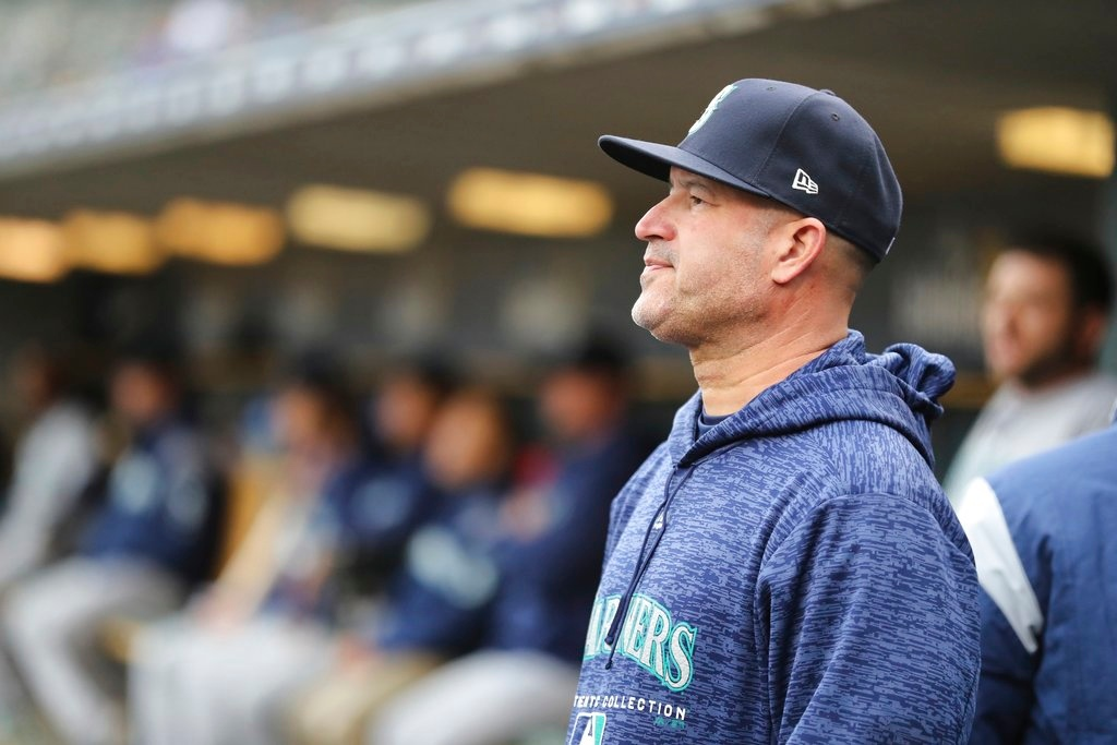. Seattle Mariners acting manager Manny Acta is seen in the dugout during the ninth inning of game one of a baseball doubleheader against the Detroit Tigers, Saturday, May 12, 2018, in Detroit. (AP Photo/Carlos Osorio)
