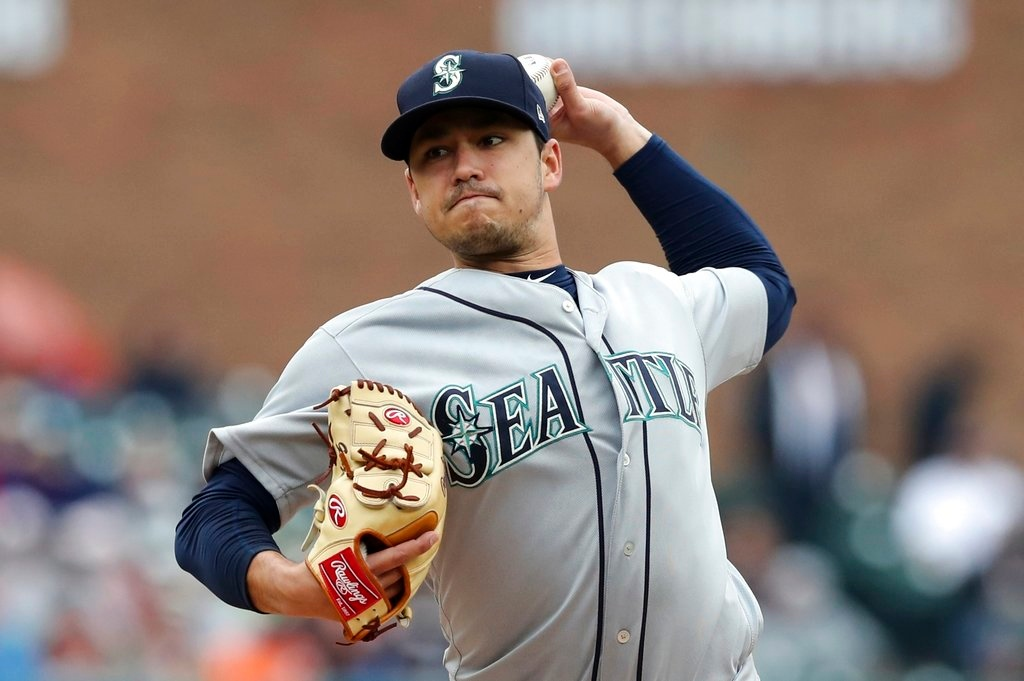 . Seattle Mariners starting pitcher Marco Gonzales throws during the first inning of game one of a baseball doubleheader against the Detroit Tigers, Saturday, May 12, 2018, in Detroit. (AP Photo/Carlos Osorio)