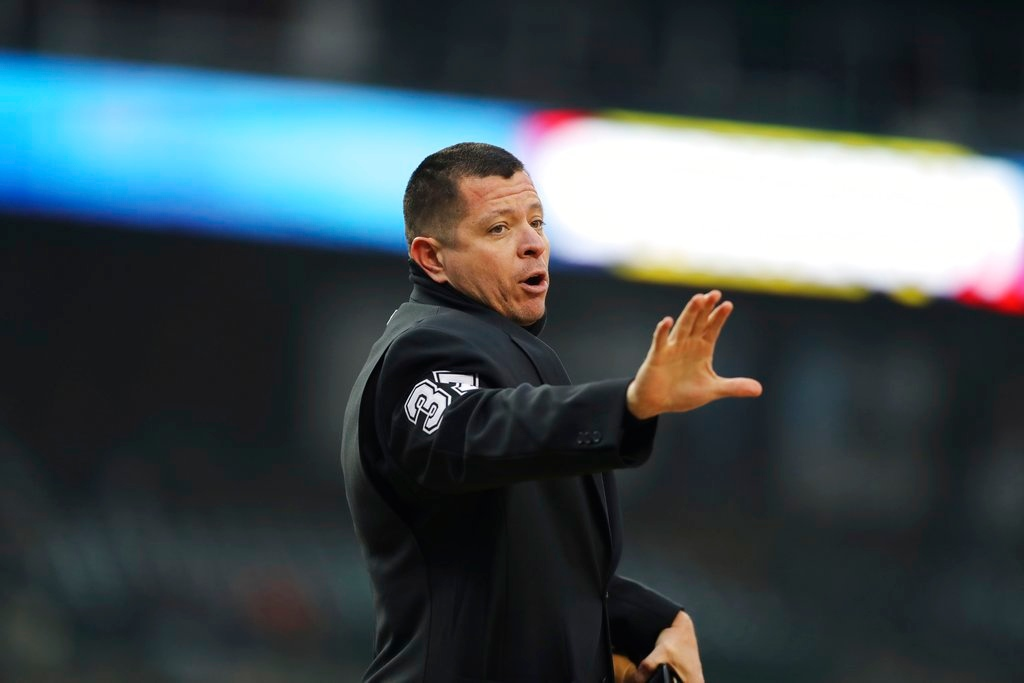 . Home plate umpire Carlos Torres gestures towards the Seattle Mariners bench during the first inning of game two of a baseball doubleheader against the Detroit Tigers, Saturday, May 12, 2018, in Detroit. (AP Photo/Carlos Osorio)