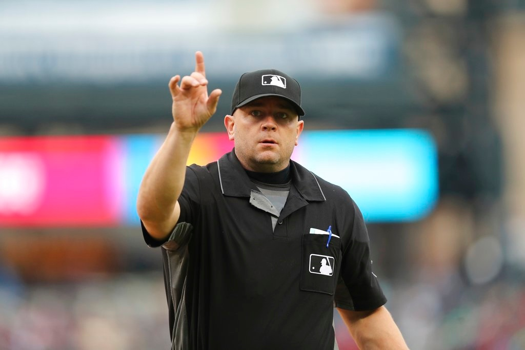 . Home plate umpire Scott Barry gestures towards the Seattle Mariners bench during the ninth inning of game one of a baseball doubleheader against the Detroit Tigers, Saturday, May 12, 2018, in Detroit. (AP Photo/Carlos Osorio)