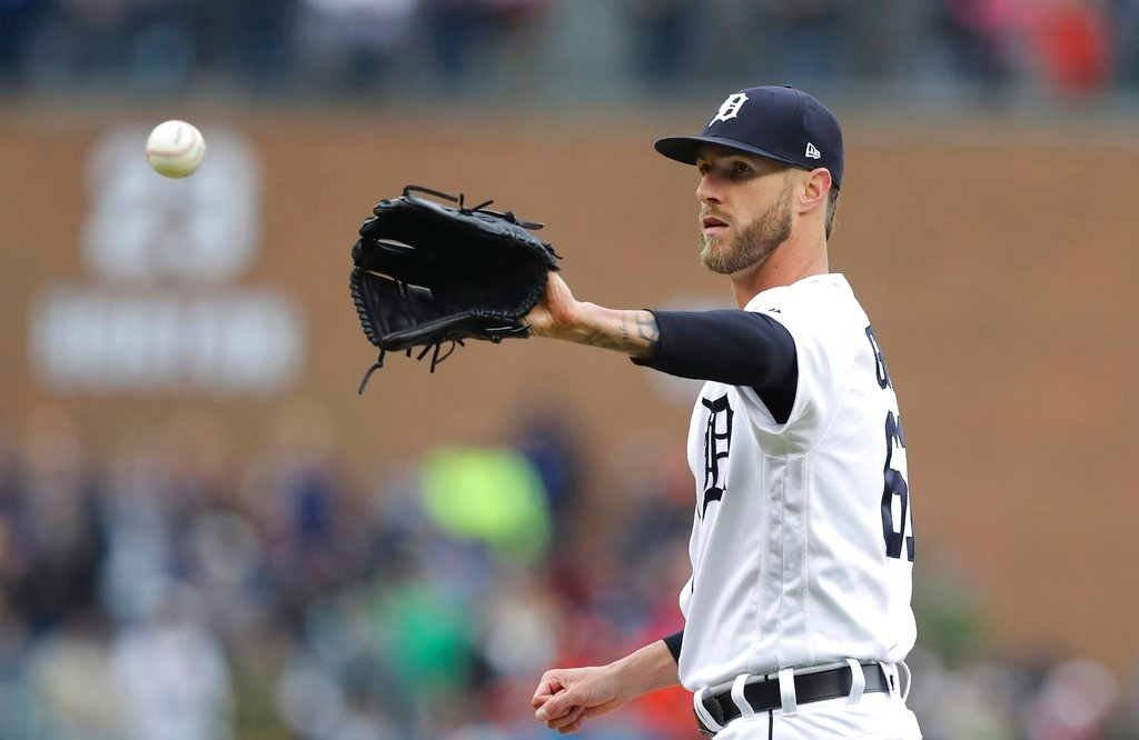 . Detroit Tigers relief pitcher Shane Greene receives a new ball during the ninth inning of game one of a baseball doubleheader against the Seattle Mariners, Saturday, May 12, 2018, in Detroit. (AP Photo/Carlos Osorio)