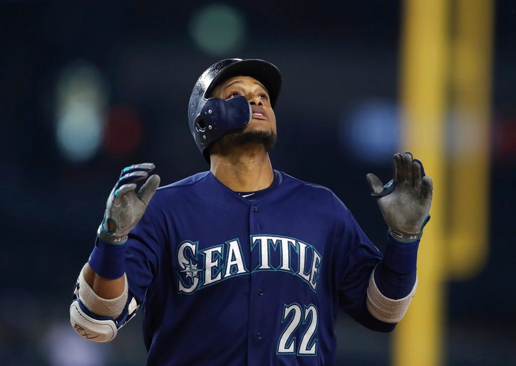 . Seattle Mariners\' Robinson Cano looks skyward as he crosses home plate after hitting a three-run home run during the fifth inning of the second game of a baseball doubleheader against the Detroit Tigers, Saturday, May 12, 2018, in Detroit. (AP Photo/Carlos Osorio)