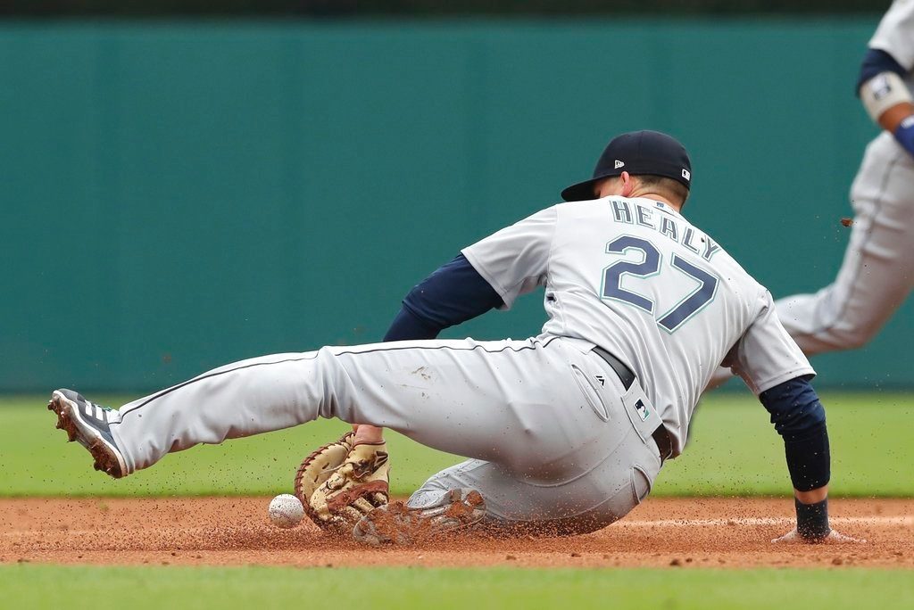 . Seattle Mariners first baseman Ryon Healy misplays a single hit by Detroit Tigers\' Nicholas Castellanos during the third inning of game one of a baseball doubleheader, Saturday, May 12, 2018, in Detroit. (AP Photo/Carlos Osorio)