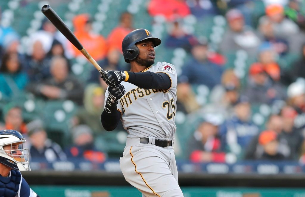 . Pittsburgh Pirates\' Gregory Polanco connects on his three-run home run during the 13th inning of a baseball game against the Detroit Tigers, Friday, March 30, 2018, in Detroit. (AP Photo/Carlos Osorio)